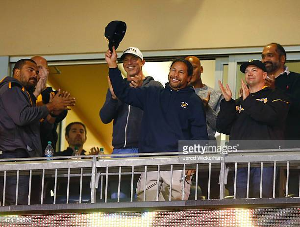 Members of the Pittsburgh Steelers current and former including Chris Hoke Cameron Heyward Ryan Shazier and Franco Harris honor recently retired...