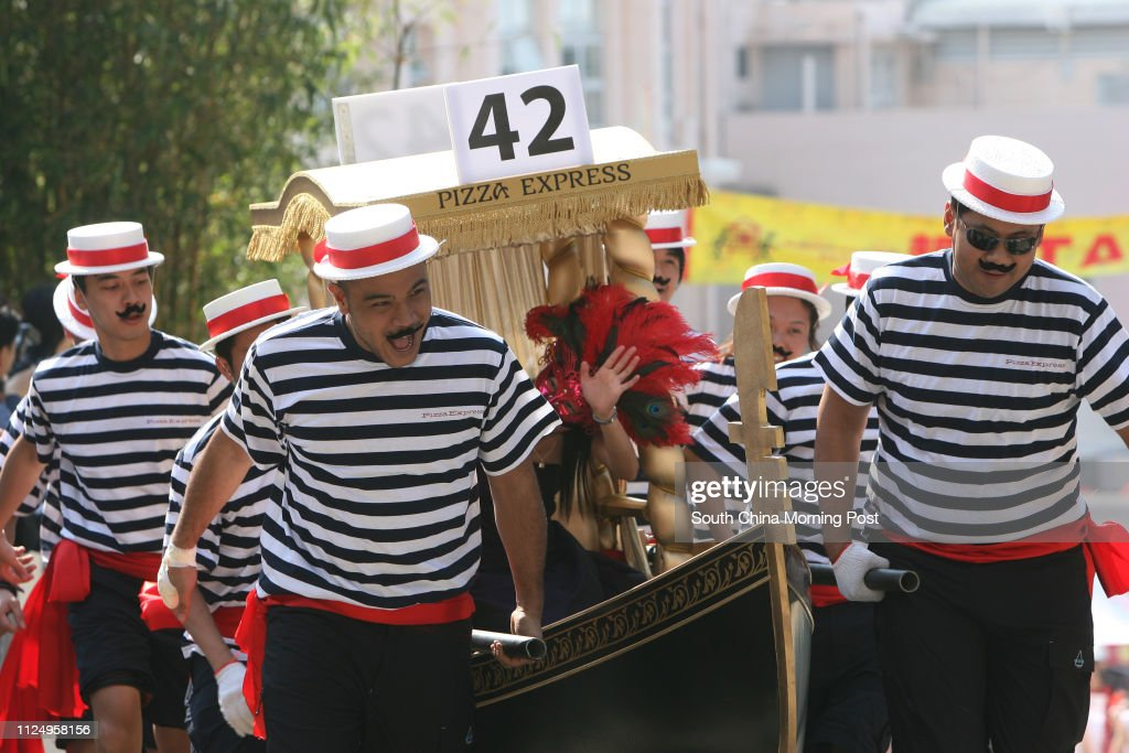Members of the Pizza Express running on the Sedan chair race.  Over 600 peoples running for Matilda Sedan Chair race to raise funds for Matilda International Hospital.  The annual Sedan Chair Race and Matilda Bazaar take place on The Peak.  12 November 20 : News Photo