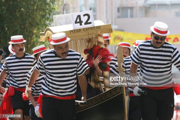 Members of the Pizza Express running on the Sedan chair race Over 600 peoples running for Matilda Sedan Chair race to raise funds for Matilda...