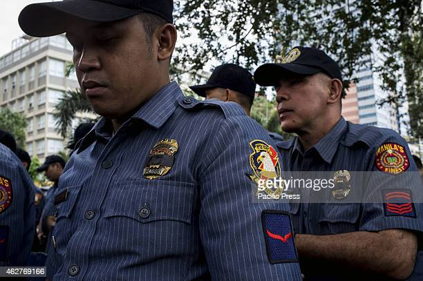 MANILA PHILIPPINES MANILA PHILIPPINES Members of the PNP wear black ribbon on their badges to support their fallen comrades in the Mamasapano incident