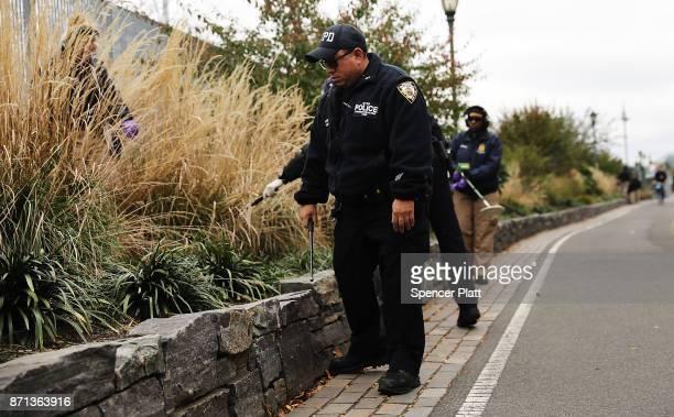 Members of the police department's crime scene unit search the location where terrorist Sayfullo Saipov drove down a Manhattan bike path and went on...