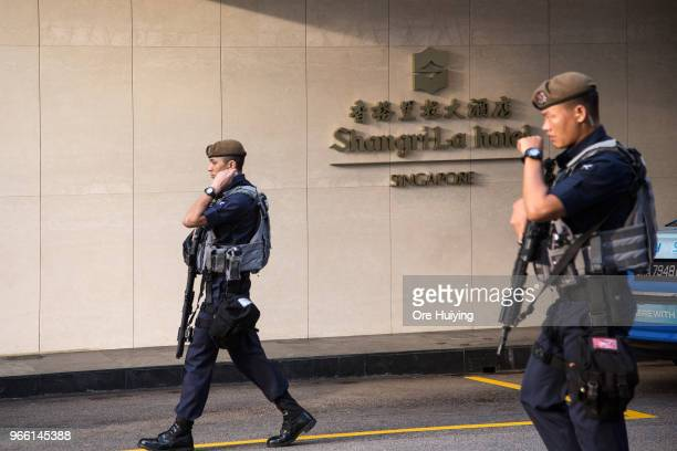 Members of the police force patrol outside the Shangrila Hotel during the ShangriLa Dialogue on June 2 2018 in Singapore US President Donald Trump...