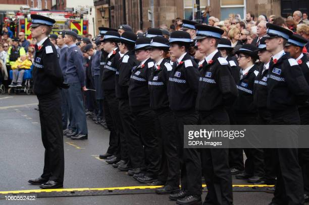 Members of the police force seen taking part in the annual remembrance parade which this year marked the centenary of the armistice which ended the...