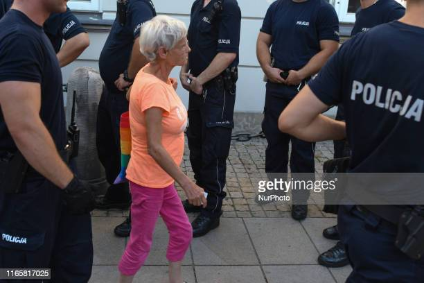 Members of the Police Forces release an activist after an anti-war march-demonstration 'Never Again!' organized in Warsaw city center as part of the...