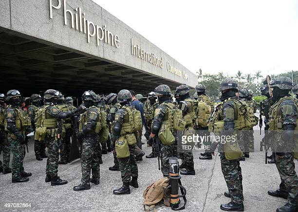 Members of the police Special Action Force stand in front of the Philippine convention center, after a drill simulating a Paris-like attack at the...