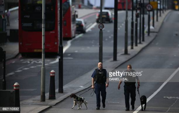 Members of the Police with sniffer dogs work on London Bridge in London on June 4 following a terror attack Fortyeight people have been taken to...