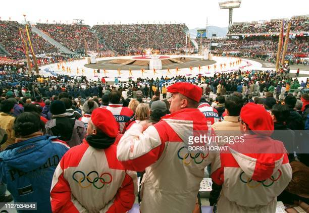 Members of the Polish delegation to the 18th Winter Olympic Games sport the Olympic flag on the back of their jackets during the games' opening...