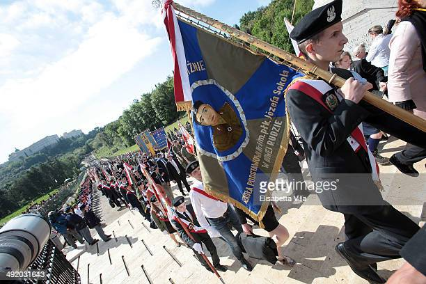 Members of the Polish guard march during the Polish commemoration service ceremony at Polish Cemetery on May 18 2014 in Monte Cassino Italy Prince...