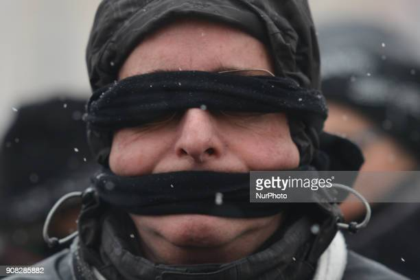Members of the Polish opposition and activists wearing black bands in front of their eyes and mouth aligned equally in rows silent for 20 minutes...