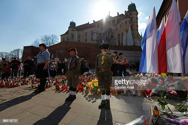 Members of the Polish Scouts youth organization stand guard in honor of the late polish President Lech Kaczynski and his wife Maria near the castle...