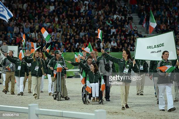 Members of the Polish Team during the Parade of Nations at the Opening Ceremony of the ALLTECH FEI WORLD EQUESTRIAN GAMES 2014 at Stade Malherbe in...