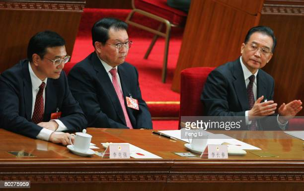Members of the Politburo Li Keqiang, Li Changchun and China's Premier Wen Jiabao attend the seventh plenary session of the National People's Congress...