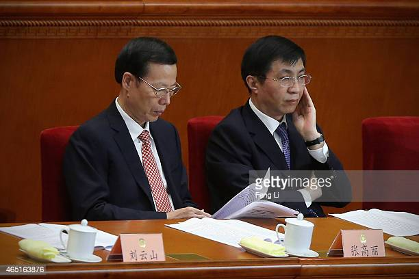 Members of the Political Bureau of the CPC Central Committee Wang Huning and Zhang Gaoli attend the opening session of the Chinese People's Political...