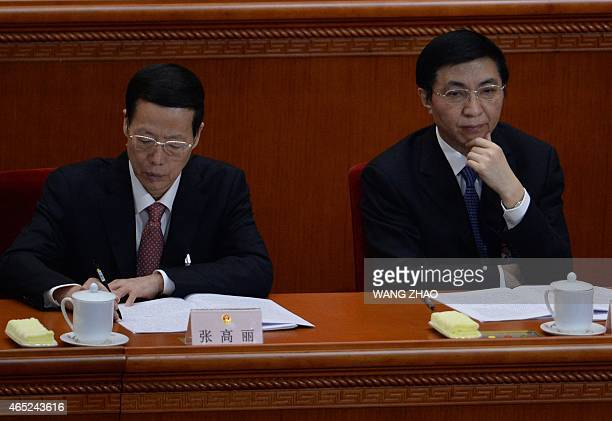 Members of the Political Bureau of the CPC Central Committee Zhang Gaoli and Wang Huning attend the opening of the third session of the 12th National...