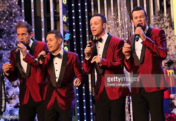 Members of the pop group Human Nature perform on stage at the Universal CityWalk Tree Lighting Light Show Spectacular at 5 Towers Outdoor Concert...