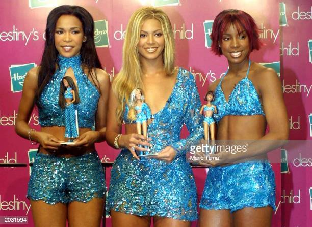 Members of the pop music group Destiny's Child Michelle Williams Beyonce Knowles and Kelly Rowland pose for a photograph with their Destiny's Child...