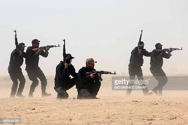 Members of the popular mobilisation unit attend a combat training session at a military camp in the Iraqi Shiite shrine city of Karbala in central...