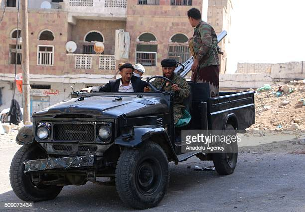 Members of the Popular Resistance Committees loyal to Yemeni President Abdrabbu Mansour Hadi make preparations before they stage attacks against the...