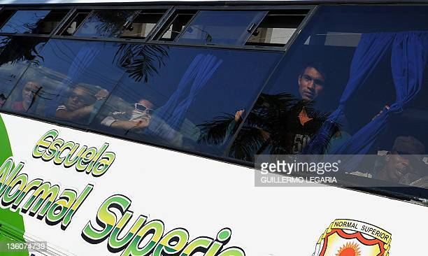 Members of the Popular Revolutionary AntiTerrorist Army of Colombia arrive on an escorted bus at the Las Malocas recreational park on the outskirts...