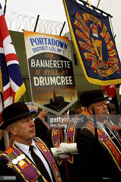 Members of the Portadown Orange Order gather at an Army barricade at Drumcree Church July 8, 2001 in Portadown, Northern Ireland after police blocked...