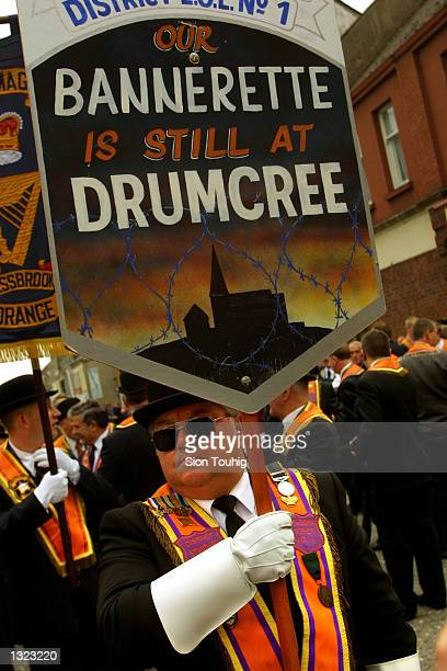 Members of the Portadown Orange Order march June 8, 2001 through Portadown, Northern Ireland to a rally at Drumcree Church. A massive Army and Police...