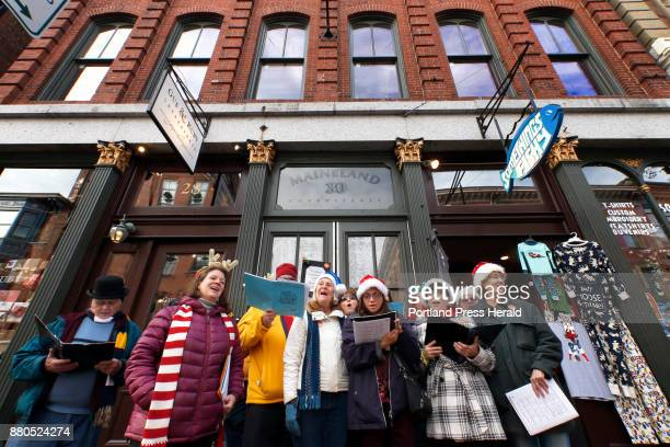 Members of the Portland Community Chorus perform Chistmas carols outside Something's Fishy gift shop on Exhange Street on Saturday Something's Fishy...