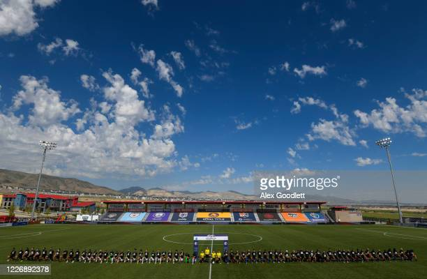 Members of the Portland Thorns FC and OL Reign take a knee before a game on day 8 of the NWSL Challenge Cup at Zions Bank Stadium on July 13 2020 in...