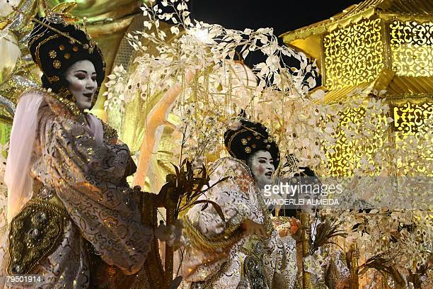 Members of the Porto da Pedra samba school perform during the first night of the carnival parade at the Sambodrome in Rio de Janeiro on February 3...