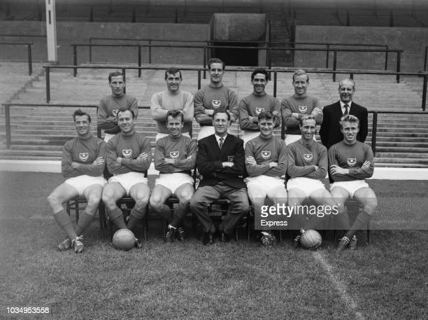 Members of the Portsmouth Football Club team squad pose for a group photo together with manager George Smith on the pitch at the club's Fratton Park...