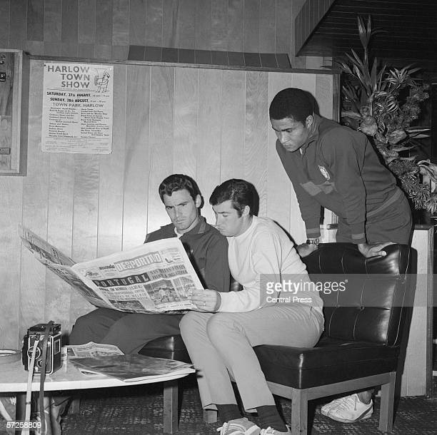 Members of the Portuguese football team reading a paper from home in the foyer of the Saxon Inn Hotel in Harlow Essex during the 1966 World Cup in...