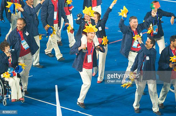 Members of the Portuguese team wave to the crowd during entrance of Athletes in the Opening Ceremony for the 2008 Paralympic Games at the National...