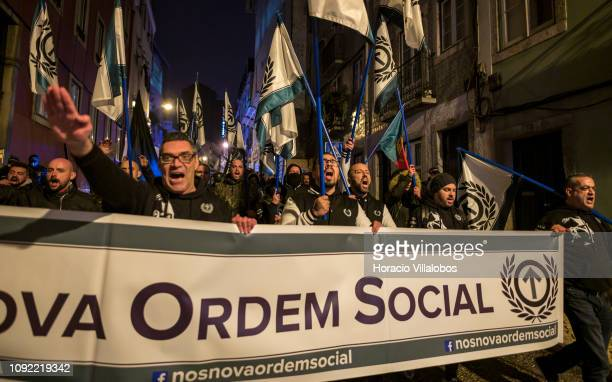 Members of the Portuguese ultra right Nova Ordem Social party led by nationalist activist Mário Machado carry flags and perform the fascist salute...