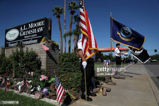 Members of the POWMIAKIA Honor Guard stand watch at a makeshift memorial for US Sen John McCain outside of the AL Moore Grimshaw mortuary on August...
