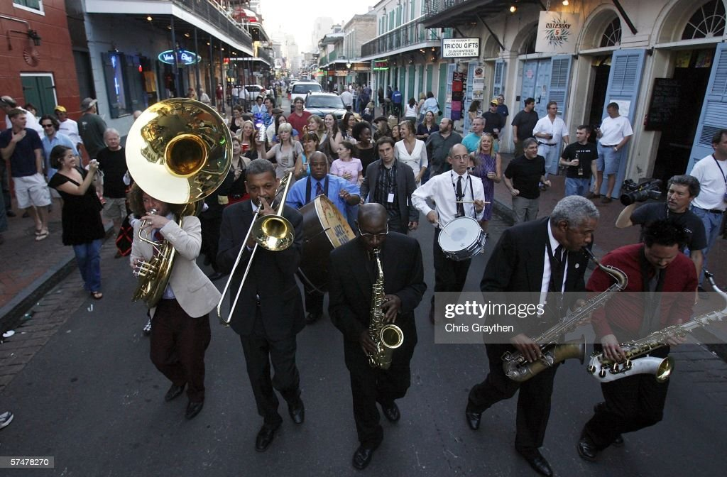 Members of the Preservation Hall Jazz Band lead a second line parade down Bourbon Street during the grand re-opening of Preservation Hall on April 27, 2006 in New Orleans, Louisiana. Preservation Hall has been closed since Hurricane Katrina hit the area eight months ago.