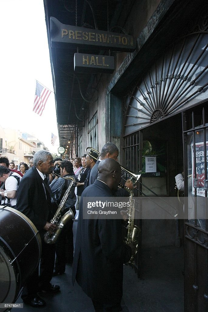 Members of the Preservation Hall Jazz Band second line through the French Quarter during the grand re-opening of Preservation Hall on April 27, 2006 in New Orleans, Louisiana. Preservation Hall has been closed since Hurricane Katrina hit the area eight months ago.