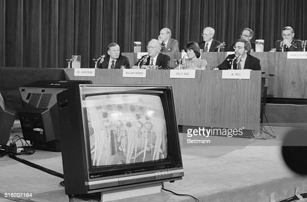 Members of the presidential commission probing the Challenger disaster watch 2/27 as a picture showing ice on the space shuttle appears on a TV...