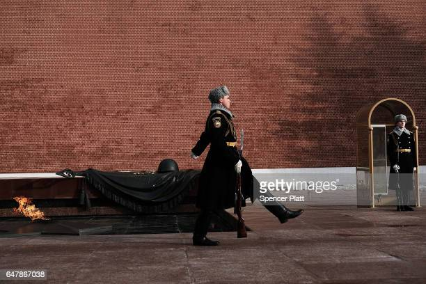 Members of the Presidential Regiment march in the Changing of the Guard ceremony at the Tomb of the Unknown Soldier on March 4, 2017 in Moscow,...