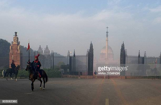 Members of the President's Bodyguard a cavalry regiment of the Indian Army stand guard outside Rashtrapati Bhawan the official home of the Indian...