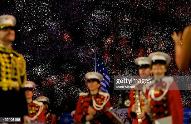 Members of the President's Own Marine Band stand during a fireworks display commemorating the bicentennial of the writing of The StarSpangled Banner...