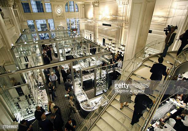 Members of the press and guest take a tour of the new Wall Street store of Tiffany Co during the opening ceremony 10 October 2007 The store located...
