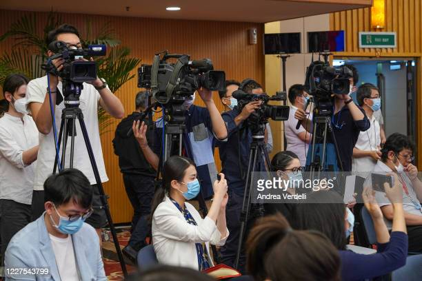 Members of the press attend the video press conference of Chinese Premier Li Keqiang located in The Great Hall Of The People after the closing of the...