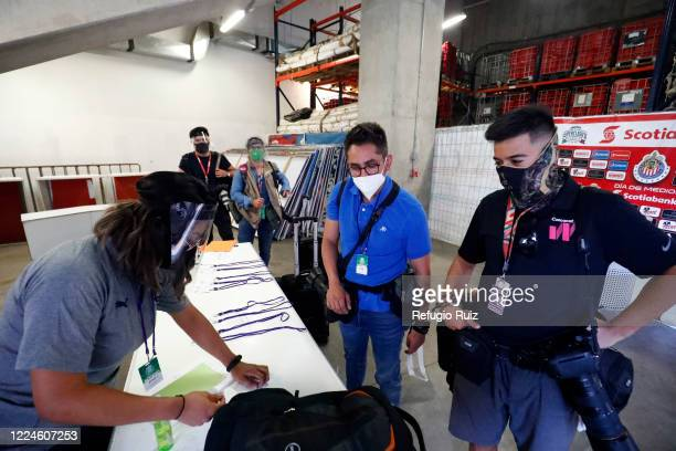 Members of the press await to receive authorization to get in the field as part of the COVID 19 protocol prior to match between Mazatlan FC and...