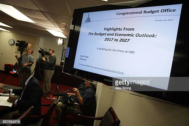 Members of the press cover a Congressional Budget Office media briefing January 24 2017 in Washington DC The Congressional Budget Office held a media...