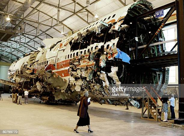 Members of the press examine a 93foot section of the TWA Flight 800 fuselage that sits inside a stateoftheart training facility of the new NTSB...