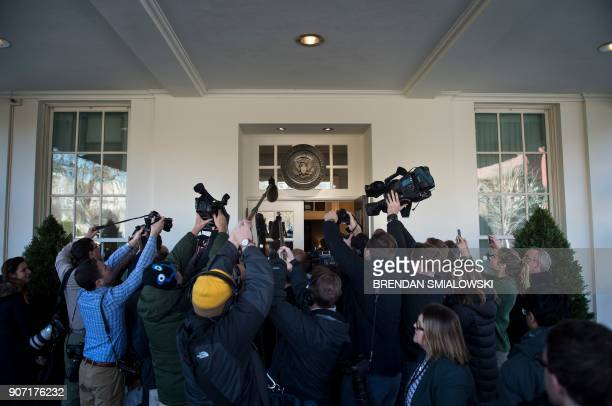 TOPSHOT Members of the press follow Counselor to US President Donald Trump Kellyanne Conway while she speaks about a potential government shutdown...