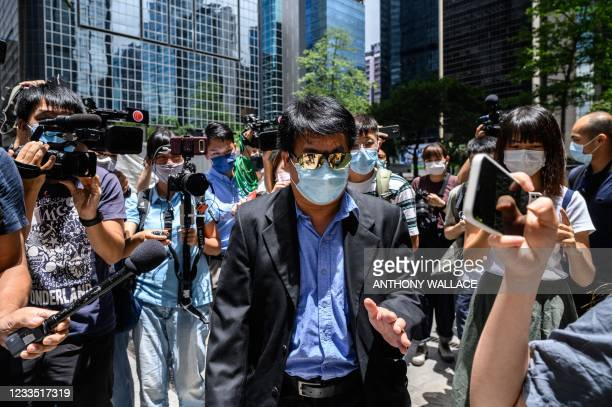 Members of the press follow defendant Wong Chi Wing , one of eight men accused of attacking pro-democracy protesters in Yuen Long in 2019, as he...