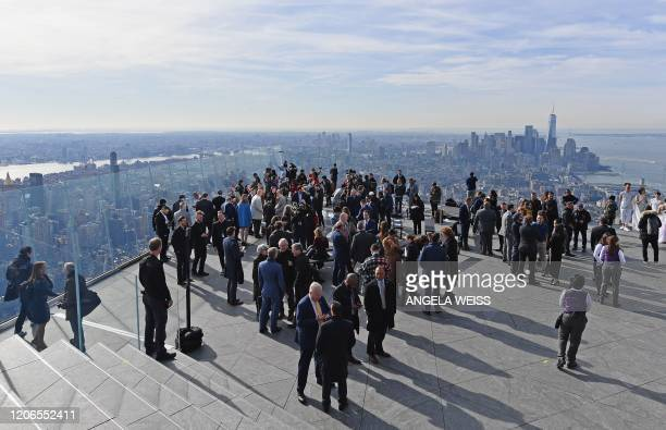 Members of the press gather at the opening of Edge the Western Hemisphere's highest outdoor sky deck in New York City on March 11 2020 Edge offers...