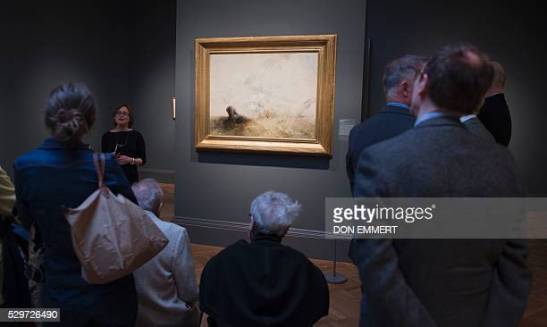 Members of the press get a preview of JMW Turner's quartet of whaling paintings in an exhibition at the Metropolitan Museum of Art on May 9 2016 in...