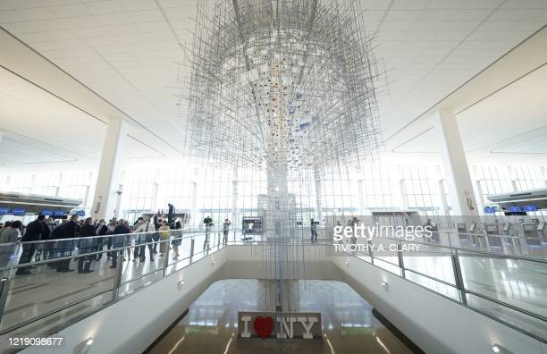 Members of the press get a tour of LaGuardia Airport's newly renovated Terminal B on June 10 in New York. - The terminal opens to the public on June...
