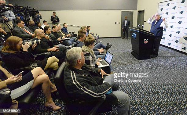Members of the press listen as Carolina Panthers general manager Dave Gettleman answers a question during his end of season press conference on...